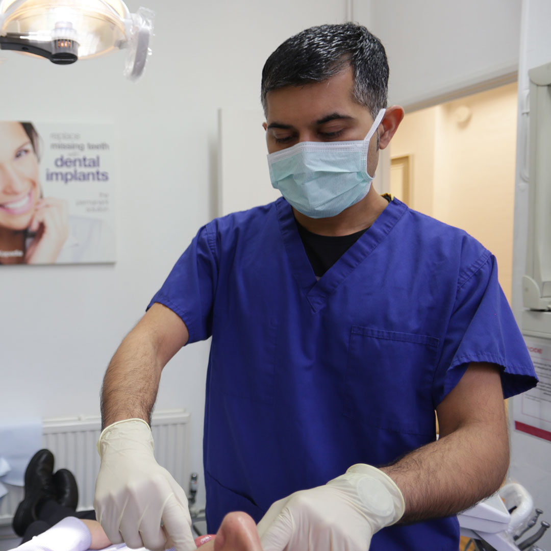 Image of a dentist doing dental work